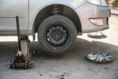Replacement tires on the car at the service station — Stock Photo