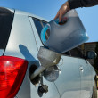 Pouring fuel into the car gas tank — Stock Photo