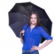 Lovely woman with black umbrella against white background — Stock Photo