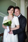 Wedding photo of happy bride and groom in the palace — Stock Photo