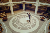 Bride and groom dancing in the palace — Stock Photo