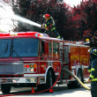 Firemen and fire truck at an apartment fire — Stock Photo #18871645