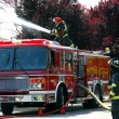 Firemen and fire truck at apartment fire — Stock Photo #18871645