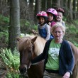 Girls on the horse riding — Stock Photo