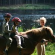 Girls on the horse riding — Stock Photo #18758559