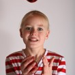 Girl juggling with red Cristmas toy — Stock Photo #18761167