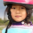 Girl  in a pink helmet - Stock Photo