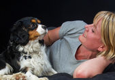 Mature woman with dog — Stock Photo