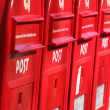 Red post boxes - Stock Photo