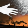 Chimney and fumes with a hand — Stock Photo
