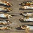 Stock Photo: Plenty of small dried fishes on stack