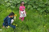 Girls picking up flowers — Stock Photo