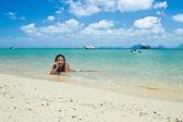 Girl lying in the water — Stock Photo