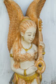 Statue of girl playing an asian string instrument — Stock Photo