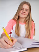 Scandinavian cute young girl writting — Stock fotografie