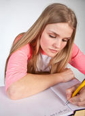 Scandinavian cute young girl writting — Stock Photo