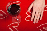 Hands shaping a heart and wine glass — Stock Photo
