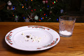 Christmas Cookie Crumbs and Empty Milk Glass Christmas Cookie Crumbs and Empty Milk Glass — Stock Photo