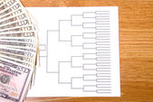 March Madness Bracket and Fanned Money — Stock Photo