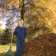 Raking Leaves Teen Boy Next To Leaf Pile — Stock Photo