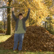 Raking Leaves Triumphant Boy — Stock Photo