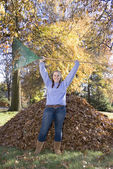 Raking Leaves Triumphant Girl — Stock Photo