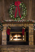 Christmas Fireplace Hearth with Wreath and Stockings — Stock Photo