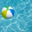 Beach Ball Floating in Pool — Stock Photo #48863167