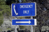 Telephone urgently on the edge of an Australian road — Stock Photo