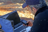 Preparation of the day of exploration in the Australian desert by GPS — Stock Photo