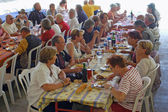 Banquet of tourists on holiday — Stock Photo