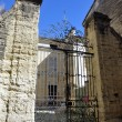 Old building of Uzes in restoration - Stock Photo