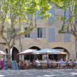 Be in hiding of restaurant on a place of Uzes - Stock Photo