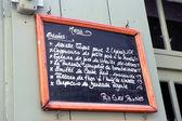 Menu of restaurant on a slate — Stock Photo