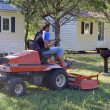 To mow lawn with camp-site before season — Stock Photo #23716881