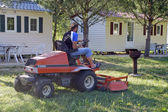 To mow the lawn with the camp-site before the season — Stock Photo