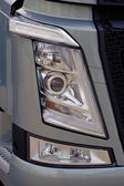 Close-up on a headlight of new truck — Stock Photo