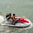 Photographer on jet ski — Stock Photo