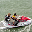 Photographer on jet ski — Stock Photo #28428355
