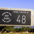Stock Photo: Sign a forest footpath