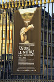 Poster exhibition on the railings of our castle of Versailles — Stock Photo