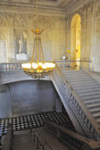 A monumental staircase of the palace of Versailles — Stock Photo