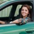 Happy young woman driving car — Stok fotoğraf