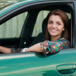 Happy young woman driving car — Foto Stock