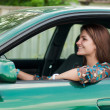 Happy young woman driving car — Stock Photo