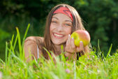 Young happy teenage girl with apple — Stock Photo