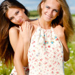 Two happy young women embracing — Stock Photo #12885062