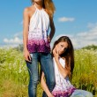 Two happy young women enjoying sun - Foto Stock