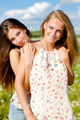 Two happy young women embracing — Stock Photo