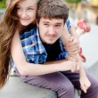 Young happy couple embracing in city — Stock Photo